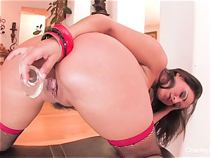 Naturally big-boobed Charley bangs herself with a glass fucktoy