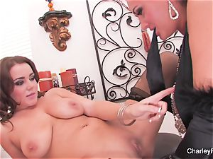 Charley and Natasha play with a double faux-cock