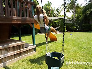 magnificent dark-haired nubile masturbates on the playground