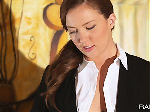 Maddy OReilly is plumbed over the desk by the boss