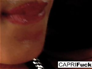 Capri Plays With Her raw cooter And impressive knockers